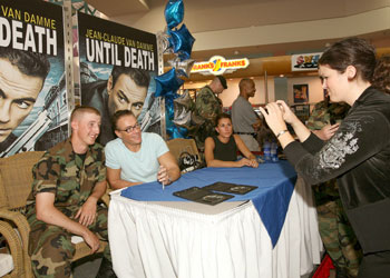 Van Damme signs copies of film 'Until Death' for wounded soldiers